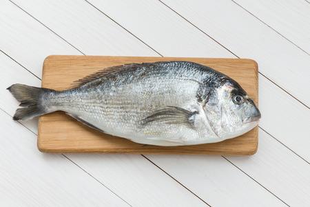 dorado fish: Fresh dorado fish on wooden cutting board