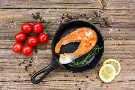 Fried salmon steak in pan