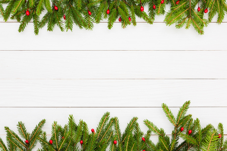 Christmas background. Christmas fir tree with decoration on white wooden board background with copy space