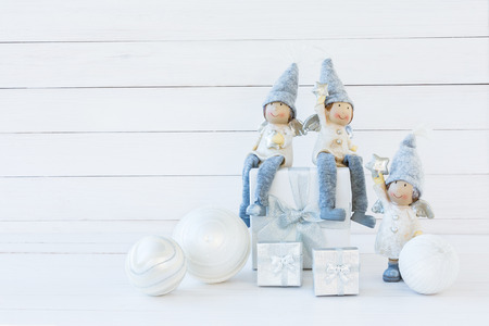 gnomos: Christmas background. Christmas composition with white gift box and gnomes. Copy space
