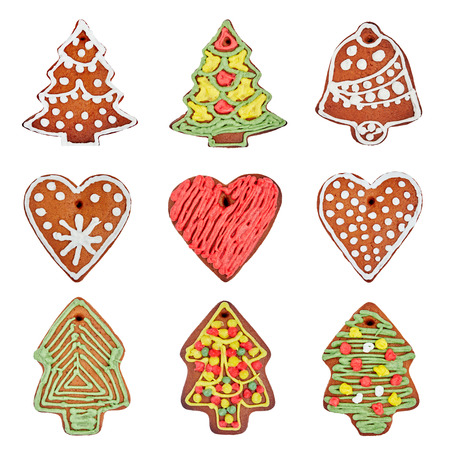 gingerbread cookies: Set of homemade gingerbread cookies isolated over white. Heart, Christmas tree, bell.