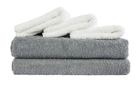 white towels: Stack of grey and white bath towels. Isolated over white background