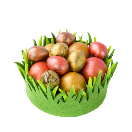 Easter eggs in green basket isolated over white background