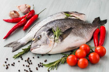 dorado fish: Raw fresh dorado fish with vegetables and spices