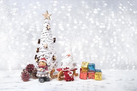 Christmas greeting card. Christmas tree, Noel gnomes, small gifts, snow texture. Christmas symbol. Stock Photo