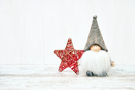 Christmas background. Christmas toys on white wooden background. Copy space