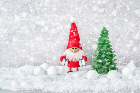 Christmas greeting card. Santa claus background with Christmas decoration  and snow. Copy space