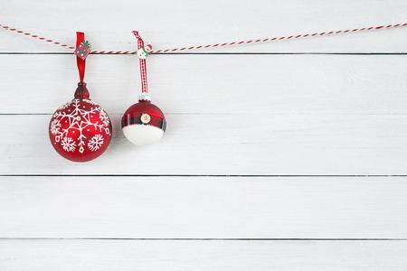 Christmas ornaments on white wooden background. Copy space. Christmas backgroubd. Minimalism Stock Photo