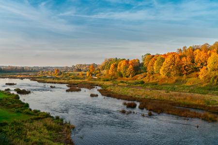 Autumn Venta river valley landscape. Sunset in october. Latvia, Kuldiga. Europe Фото со стока