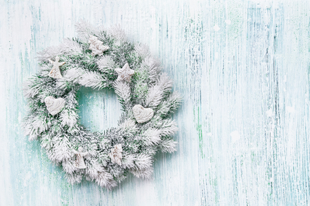 Christmas background. Christmas wreath with white decoration. Copy space, top view