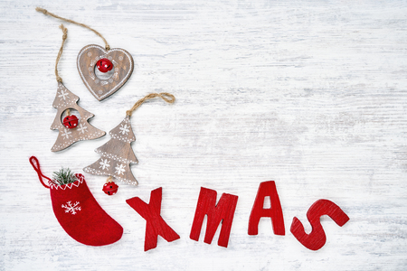 Christmas backgroud with Christmas ornaments and Red wooden letters forming word XMAS. Copy space, top view. Christmas greeting card