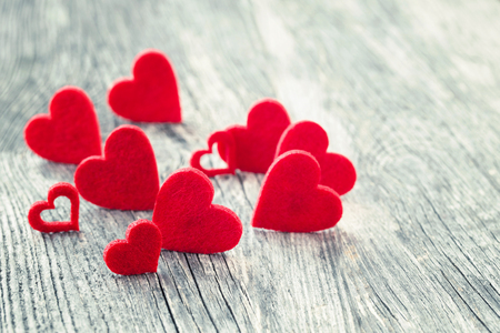 Valentines Day background. Red hearts on wooden background. Selective focus, copy space. Greeting card