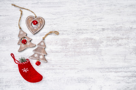 Christmas background. Colorful Christmas ornaments on white wooden background. Copy space, top view Фото со стока