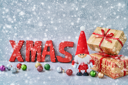Christmas greeting card with Santa Claus with Christmas ornaments and gifts. Copy space Фото со стока