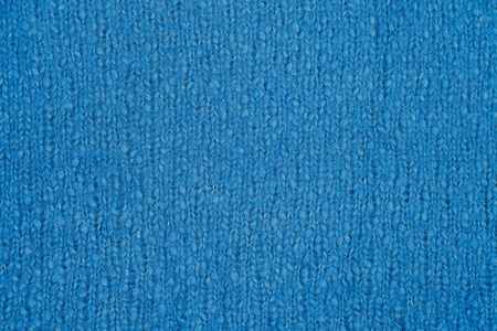 Blue knitted texture. Handmade Knitwear. Background, abstract.