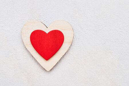 Valentines Day background with wooden hearts on a concrete background, top view. Valentines Day concept