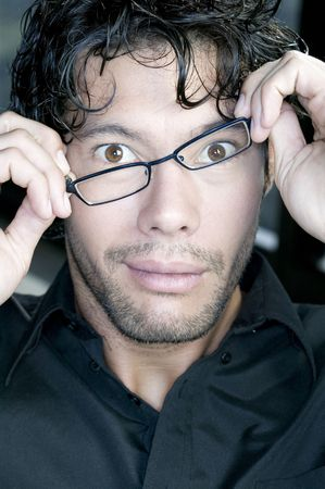 young man fixing his glasses photo