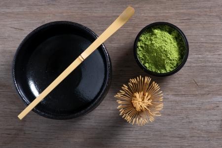 maccha: Japanese tea ceremony setting on old wooden bench. Studio photo. Green tea utensils. From top.