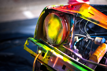 Macro shot of a car light and painted car wreck Foto de archivo