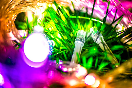 miraculous: Abstract, blurry, vibrant and colorful background. A shot of Christmas lights on a lit Christmas Tree Stock Photo