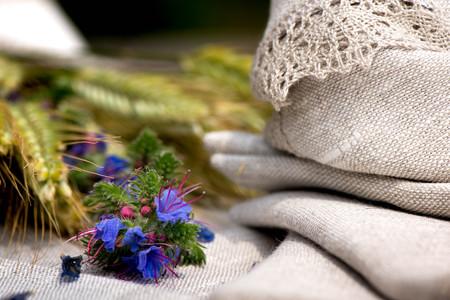 Macro shot of a linen napkins, flowers and barley Stock Photo