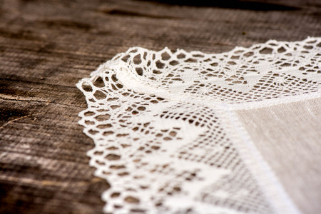 white trim: Macro shot of linen tablecloth with white lace trim Stock Photo