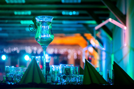 luxuriously: New years celebration, Luxuriously made tables. Music, romantic lights, champagne and wine. People are having fun. Holidays, vacation, party, fun, drinks, perfect mood to party hard all night long.