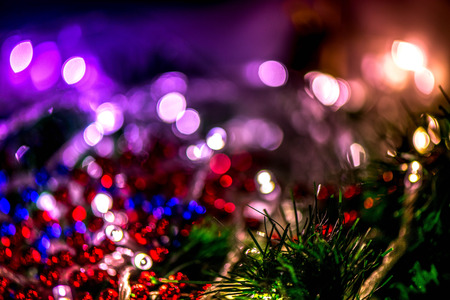 Abstract, blurry, vibrant and colorful background. A shot of Christmas decorations and lights on a lit Christmas Tree Stock Photo