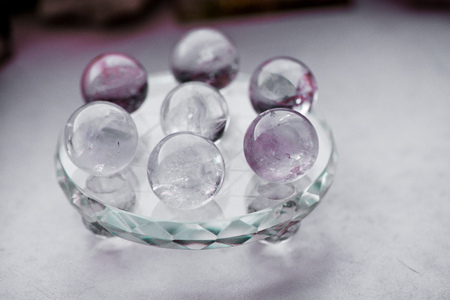 Macro shot of transparent crystal balls with colorful ornaments