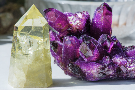 Citrine stone and amethyst. Yellow, clear crystal with dark, smokey color, smoky quartz with ornaments and rainbows in it. Amethyst is a violet variety of quartz used in jewelry. Meditative, powerful
