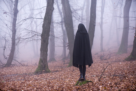 Girl in dark dress in woods