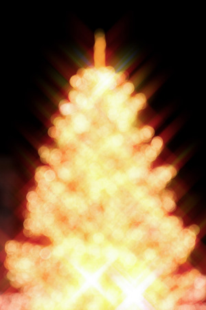 Abstract Christmas tree, colorful, blurry background. Glowing and sparkling lights in city center in Christmas market Stok Fotoğraf