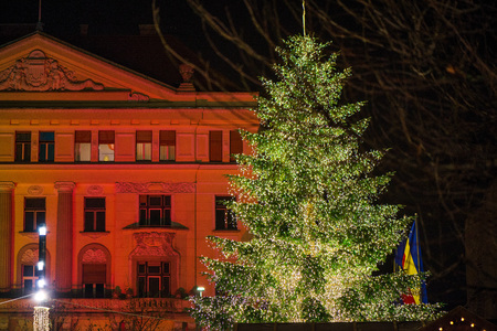 Christmas market in city center. Big, decorated Christmas tree with glowing lights Stock Photo