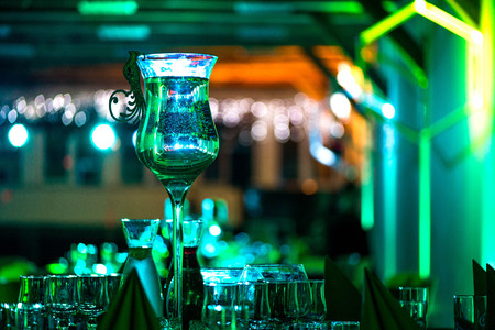 New years celebration. Luxuriously made tables. Music, romantic lights, champagne and wine. People are having fun. Holidays, vacation, party, fun, drinks, perfect mood to party hard all night long. Stock Photo