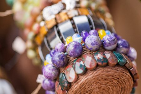 Gemstone bracelets and necklaces in a row. Jewelry made of heliotrope stone and sugilite blue stone. Healing, powerful crystal energy. Esoteric and colorful background Stock Photo