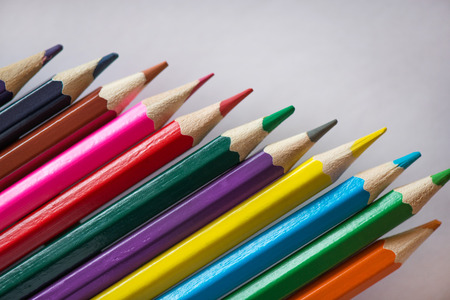 pile of sharp coloured drawing pencils on table rainbow colors