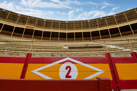 Traditional historical bull fighting ring in Spain. Deserted modern coliseum. Animal rights violation and abuse. Live bull fighting happening in modern era.