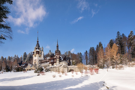 Peles castle in Romania. Beautiful, royal castle in snowy, white winter. Stock fotó