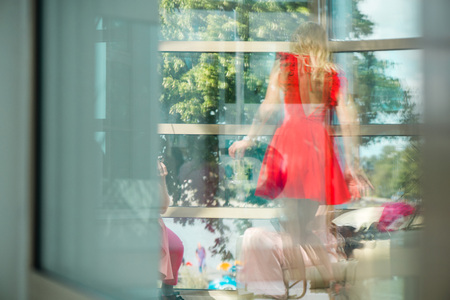 Reflection on glass window of girls party. Young women celebrating birthday or bachelorette party. Concept of surveillance and paparazzi