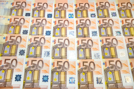 50 euro paper money on black background. Hundreds of banknotes. Concept of cash flow, finances, rich people, millionaire and successful business.