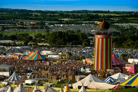 Panoramic view from the top of the hill over the entire Glastonbury Festival site, including the Ribbon tower, the Other Stage and Pyramid stage