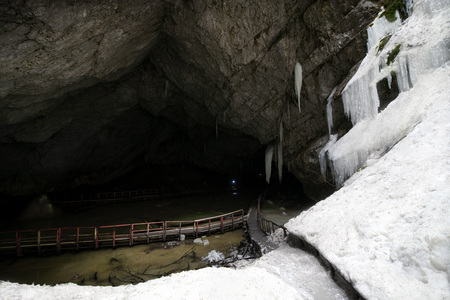 Underground glacier in Glaciers Cave in Apuseni mountains, Scarisoara, Romania. Big icicles holding on ceiling in the cave