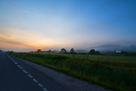 Beautiful morning on road. Sun is rising in mountains. Concept of road trip and traveling with car around Europe, Romania