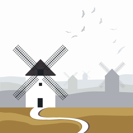Typical Spanish windmills. Road in the foreground and landscape with birds over the sky in the background.
