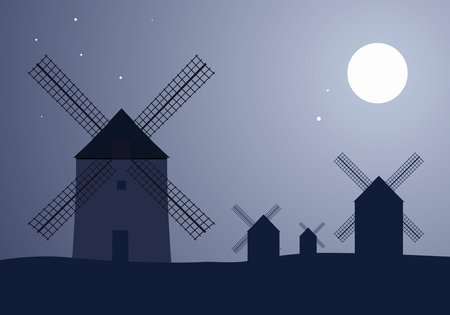 Typical Spanish windmills under the moon and stars