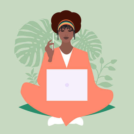 African business woman sitting comfortably with a laptop and a pencil, surrounded by plants