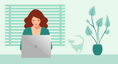 Happy and smiling businesswoman working on her computer surrounded by plants and a cat