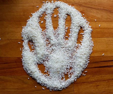 handprint on rice Stock Photo