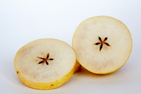 rotten pear is sliced on white background