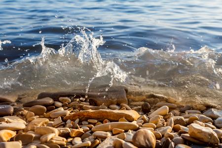 the waves break on the rocks Stok Fotoğraf